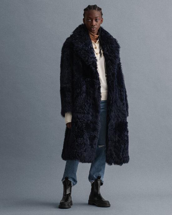 Manteau ultra-ample en peau lainée